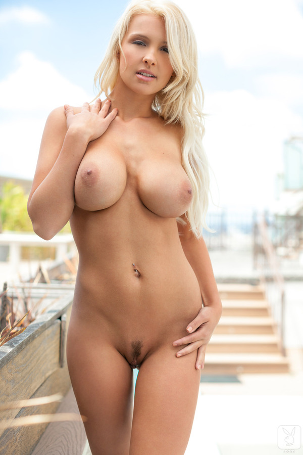Busty blonde babe with big ass rubs
